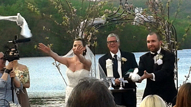 wedding dove release by the water